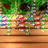 Winter christmas background. Christmas tree and pine on the wooden background Royalty Free Stock Image