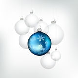 Winter Christmas Baubles. Christmas decorations! A detailed blue bauble with snowfakes with a group of glass baubles. Vector illustration Royalty Free Stock Photo