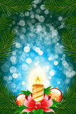 Winter Christmas card. With balls and candle in blue color Royalty Free Stock Images