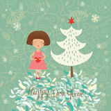 Winter Christmas card. Girl  with heart in hands on blue floral background with christmas tree Royalty Free Stock Photos