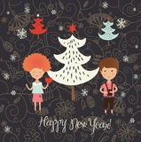 Winter Christmas card with kids. Boy and girl  with heart in hands on floral background with christmas tree Stock Photos