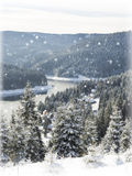 Winter Christmas  card. Snowing landscape.Mountain village Royalty Free Stock Photography