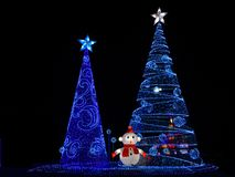Winter Christmas decorative Lights display of multiple christmas Tree stock photo