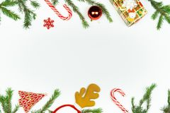 Winter Christmas flat lay with copy space for text. Top view of white background and seasonal holiday props and new year. Decorations royalty free stock photography