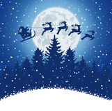 Winter christmas forest with Santa Claus rides Stock Photography