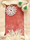 Winter Christmas frame composition. With pink fur and knitted scarf, with Christmas decorations Royalty Free Stock Photo
