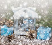 Winter. Christmas Gifts . Wooden Background with Drawn Snowfall. Toned. Stock Photos