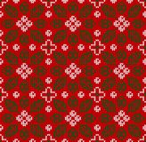 Scandinavian Winter Christmas knitted seamless floral background pattern. Leaves berries stock images