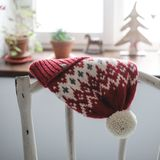 Christmas hat on blue wood plank background. Winter christmas hat on the background of the Christmas tree Royalty Free Stock Images