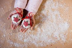 Winter christmas holidays Smiling girl red scarf white background new year. Hand writing 2018 on flour with gingerbread sweet. Female hands holding Christmas Stock Photo
