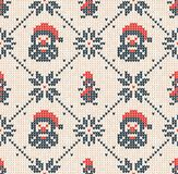 Winter Christmas knitted seamless abstract background Santa Claus, snowflakes, snowman. Winter Christmas x-mas knitted seamless abstract background with Santa Royalty Free Stock Photography