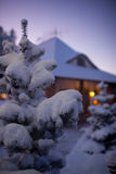 Winter Christmas landscape with smoke from the chimney house Stock Photography