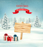 Winter christmas landscape with a wooden ornate sign background. Stock Photos