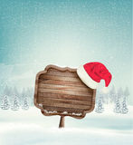 Winter christmas landscape with a wooden ornate sign Stock Photos