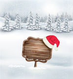 Winter christmas landscape with a wooden ornate sign Stock Image