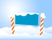 Winter /christmas Notice board. Candy cane/winter notice board on falling snow background Royalty Free Stock Image