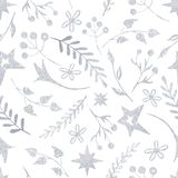 Winter Christmas pattern with white and silver silhouettes of snowflakes, berries, leaves, branches, snowman, trees. Texture for new year wallpapers, scrapbook