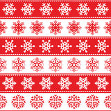 Winter, Christmas red seamless pattern with snowflakes Royalty Free Stock Photo