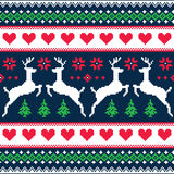 Winter, Christmas seamless pixelated pattern with deer and hearts. Nordic folk art  background -  Scandinavian embroidery style Royalty Free Stock Photography