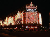 Winter & Christmas Shopping Season at Paris. Lighting decoration of the shopping mall Galeries Lafayette in Paris, France royalty free stock image