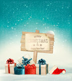 Winter christmas with a sign, gift boxes and a santa hat Stock Photography