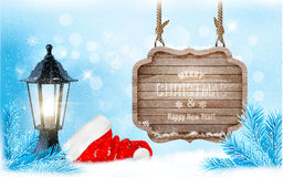 Winter christmas with a sign, lantern and a santa hat background. Vector Royalty Free Stock Image