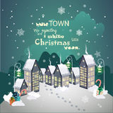 Winter Christmas street with old houses and Christmas tree with ornaments Royalty Free Stock Photography
