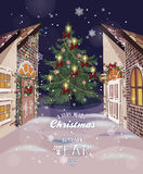 Winter Christmas street with old houses and Christmas tree with ornaments Royalty Free Stock Photo