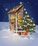 Winter Christmas street with old houses and Christmas tree with ornaments Royalty Free Stock Images