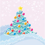 Winter. Christmas tree in nature with decoration Stock Photos