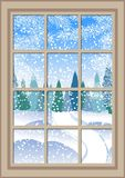 Winter Christmas window with a view of the snowy forest. Christmas card. Winter Christmas window with a view of the snowy forest. The window behind which Royalty Free Stock Images