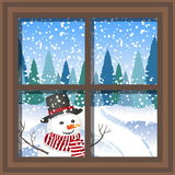 Winter Christmas window with a view of the snowy forest. Christmas card. winter window with the landscape and snowman. Winter Christmas window with a view of the Royalty Free Stock Photo