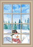 Winter Christmas window with a view of the snowy forest. Christmas card. winter window with the landscape and snowman Royalty Free Stock Images