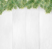 Winter christmas wooden background with fir branches and fluffy snow. Illustration Stock Photo