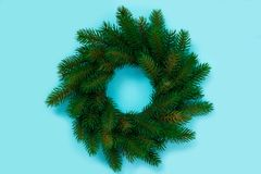 Winter and Christmas wreath with fir isolated on blue background. Top view stock images
