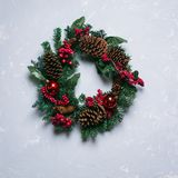 Winter and christmas wreath with pine cones. Juniper fir and ivy leaves on gray background Stock Photography