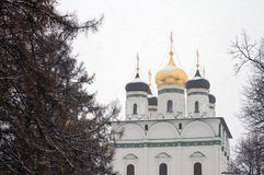 Winter church. Snowcapped orthodox christian church in Russia Royalty Free Stock Photos