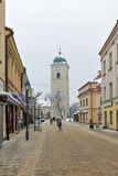 Winter church clock tower on Farny Square in Rzeszow, Poland Royalty Free Stock Images