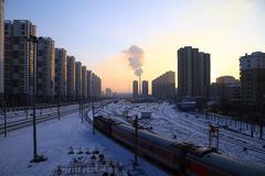 Winter city. Landscape is very chilly in the evening at sunset.A train in chinese city Royalty Free Stock Photography