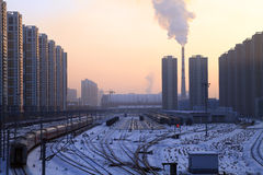 Winter city. Landscape is very chilly in the evening at sunset.A train in chinese city Royalty Free Stock Photos