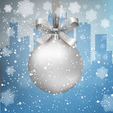 Winter city background with ball. Blue Winter background with city scape silhouette snow and snowflakes and silver glass ball with bow and ribbon,  template for Royalty Free Stock Images