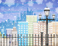 Winter city background. Winter background with city scape silhouette, iron fence, street lamp, snow and snowflakes, template for greeting or postal card new year Stock Image