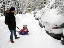 Winter, City, Dad And Cheerful Child On A Sled Stock Image