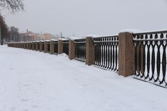 Winter embankment, swept up by snow. Winter city embankment, swept up by snow Royalty Free Stock Images