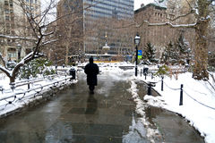Winter at City Hall Park in NYC. Snowy Scene at City Hall Park within Manhattan Stock Photos