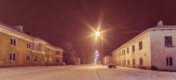 Winter city landscape. Frozen trees and buildings. Cold night. Royalty Free Stock Photography