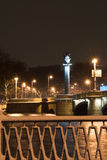 Winter city night. Bridge and embankment in the winter night of the Neva river in St Petersburg Royalty Free Stock Image