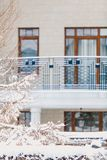 Winter city plot. Snow-covered house with balcony. Winter urban landscape. Modern house with a balcony and high windows on a quiet snowy day royalty free stock photos