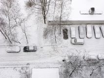 Winter, city, residential district, cars under snow, top view. Winter, all in snow. Top view on inside road of residential courtyard road in city. Cars in Royalty Free Stock Photo