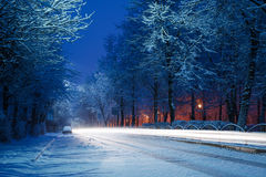 Winter city road. Spring winter road at sunrise with light from cars long exposure Royalty Free Stock Photo